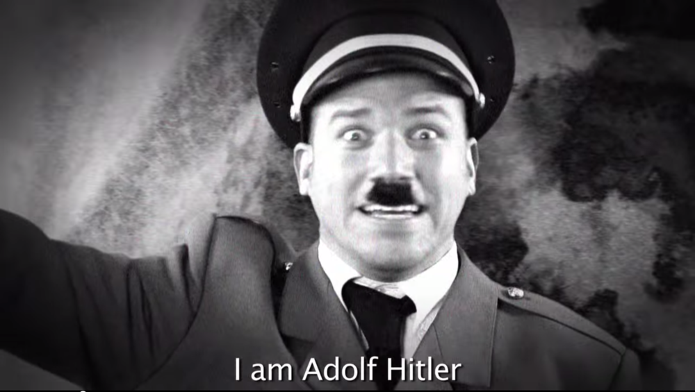 Pictured: Not actually Adolf Hitler. (Image via Epic Rap Battles of History/YouTube)